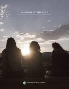 2017 Accountability Report Cover featuring three students watching sunrise over Horsetooth Reservoir